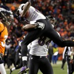 Ravens Broncos Playoffs - Baltimore Ravens tight end Ed Dickson (84) lifts Baltimore Ravens wide receiver Jacoby Jones after Jones scored a touchdown against the Denver Broncos. Image Credit: AP/Joe Mahoney
