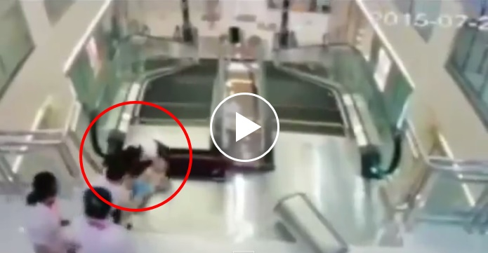 woman swallowed by escalator, woman saves son in escalator, Jingzhou, China, Chinese mall, escalator accident, Chinese Shopping Mall, CCTV